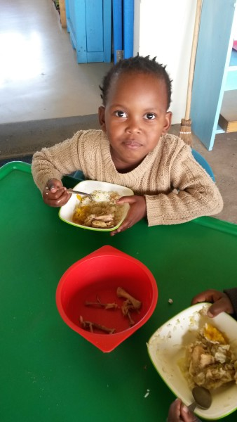 The children enjoying the food from Rotary Mthatha