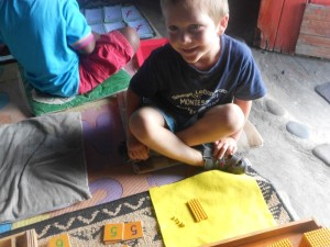 Josh, 4, working with the Golden Beads